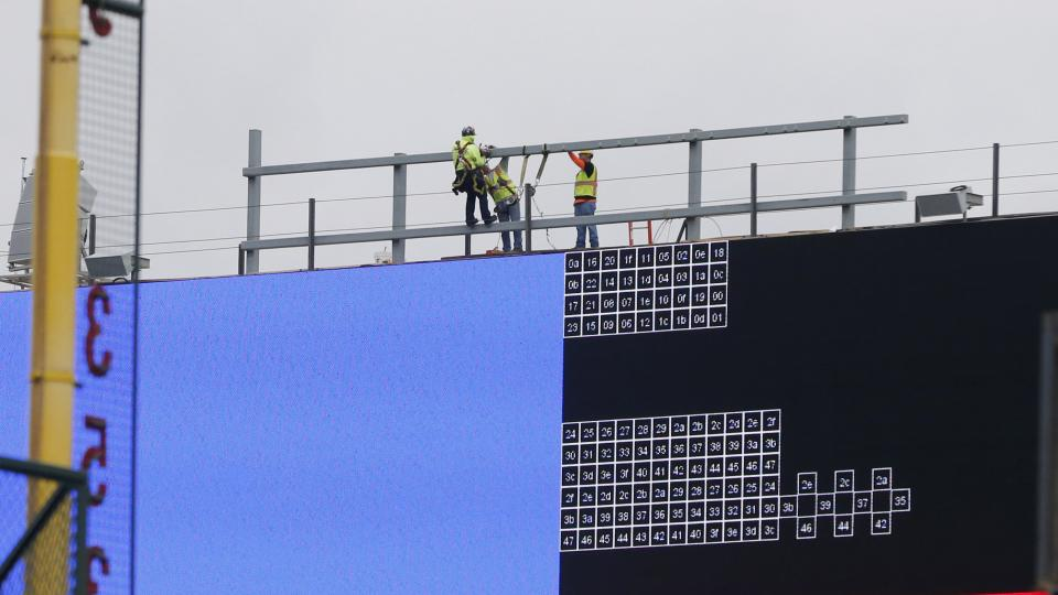 Construction continues on renovations to Wrigley Field including the installation of a Jumbotron above the left field bleachers Thursday, April 2, 2015, in Chicago. When fans arrive for the Chicago Cubs' baseball season opener Sunday, April 5, 2015, again