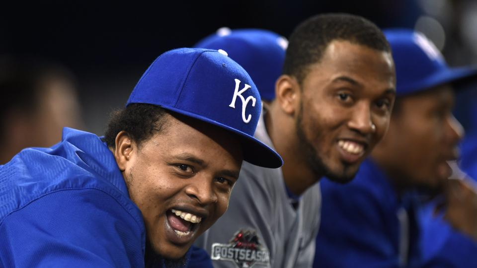 Kansas City Royals' Edinson Volquez, left, and teammates watch from the dugout during the seventh inning in Game 4 of baseball's American League Championship Series on Tuesday, Oct. 20, 2015, in Toronto. (Frank Gunn/The Canadian Press via AP) MANDATORY CR