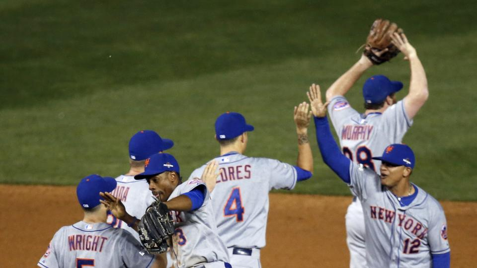 New York Mets players celebrate after Game 3 of the National League baseball championship series against the Chicago Cubs Tuesday, Oct. 20, 2015, in Chicago. The Mets won 5-2 to take a 3-0 lead in the series. (AP Photo/Charles Rex Arbogast)