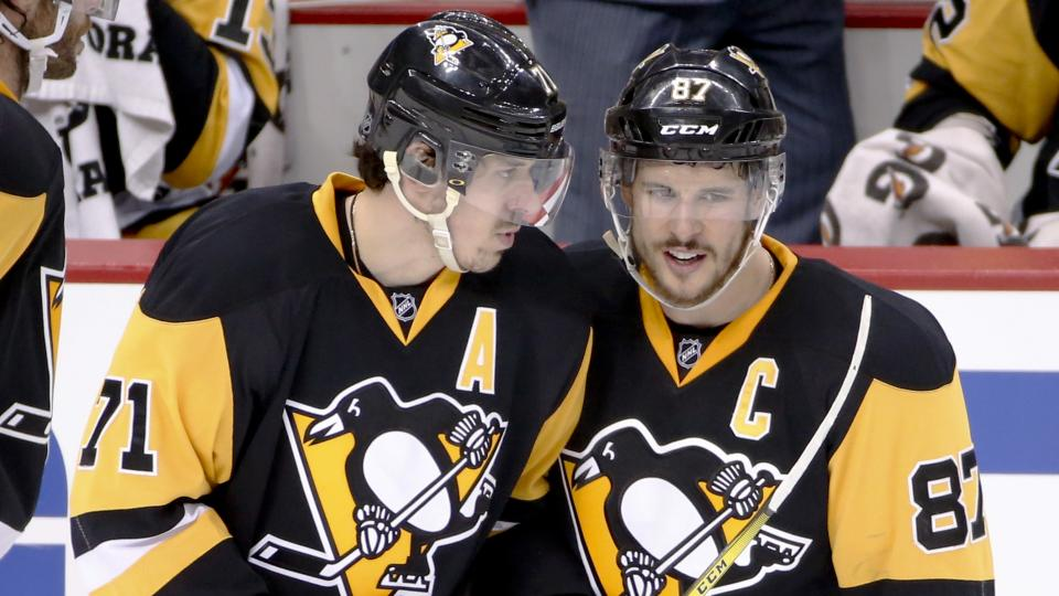 Pittsburgh Penguins' Sidney Crosby (87) and Evgeni Malkin talk as they return to the ice after a stop in play during the third period of Game 6 of the NHL hockey Stanley Cup Eastern Conference semifinals against the Washington Capitals], Tuesday, May 10,
