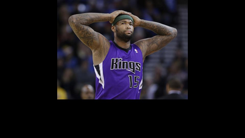 Sacramento Kings center DeMarcus Cousins (15) walks to the bench after picking up two early fouls against the Golden State Warriors during the first half of an NBA basketball game on Friday, April 4, 2014, in Oakland, Calif. (AP Photo/Marcio Jose Sanchez)