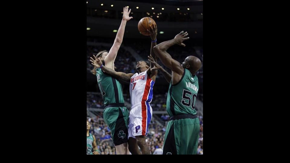 Detroit Pistons guard Brandon Jennings (7) tries going to the basket between Boston Celtics forward Kelly Olynyk, left, and center Joel Anthony (50) during the first half of an NBA basketball game Saturday, April 5, 2014, in Auburn Hills, Mich. (AP Photo/