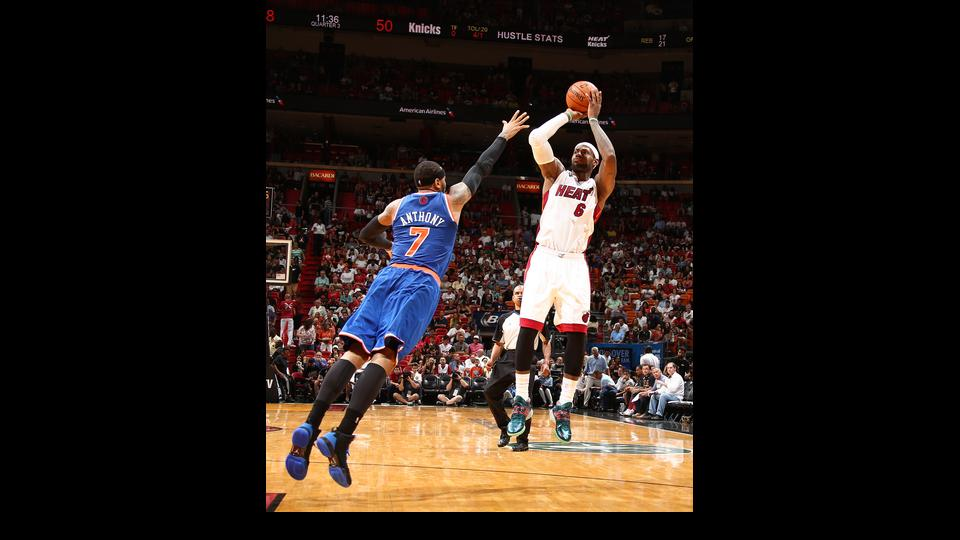 MIAMI, FL - APRIL 6: LeBron James #6 of the Miami Heat shoots over Carmelo Anthony #7 of the New York Knicks during a game on April 6, 2014 at American Airlines Arena in Miami, Florida.  (Photo by Nathaniel S. Butler/NBAE via Getty Images)