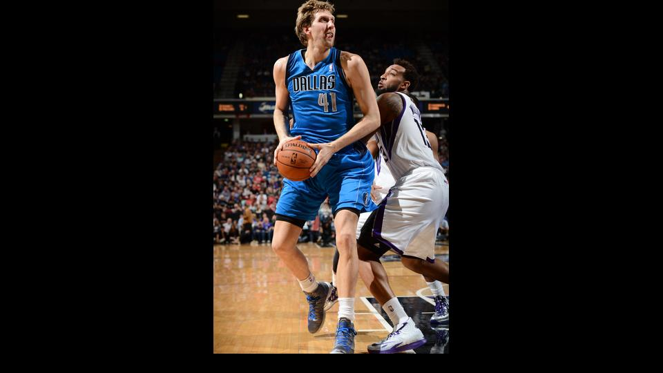 SACRAMENTO, CA - APRIL 6:  Dirk Nowitzki #41 of the Dallas Mavericks looks to shoot the ball against the Sacramento Kings at Sleep Train Arena on April 6, 2014 in Sacramento, California. (Photo by Garrett Ellwood/NBAE via Getty Images)