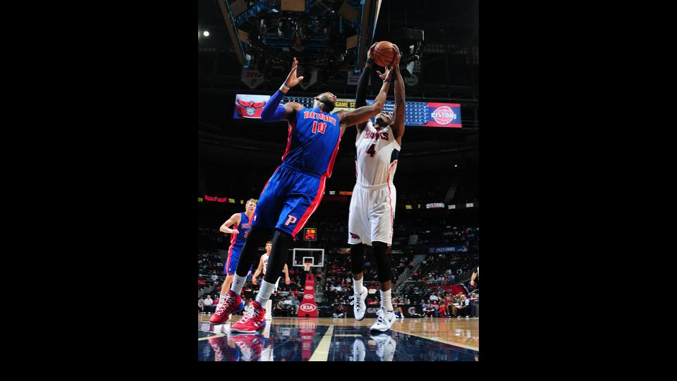 ATLANTA, GA - APRIL 8: Paul Millsap #4 of the Atlanta Hawks and Andre Drummond #10 of the Detroit Pistons attempt to rebound the ball during the game on April 8, 2014 at Philips Arena in Atlanta, Georgia.  (Photo by Scott Cunningham/NBAE via Getty Images)