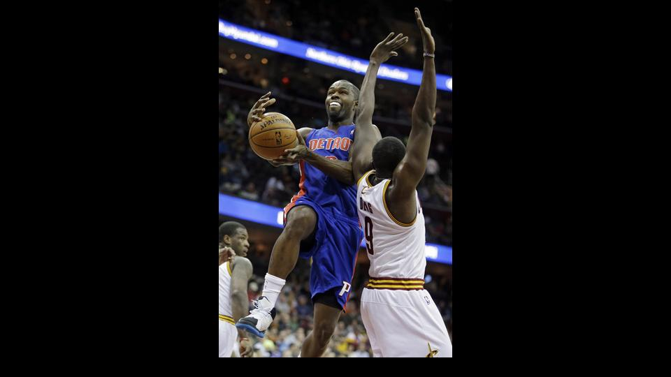 Detroit Pistons' Rodney Stuckey goes for a shot against Cleveland Cavaliers' Luol Deng (9) in the first quarter of an NBA basketball game Wednesday, April 9, 2014, in Cleveland. (AP Photo/Mark Duncan)