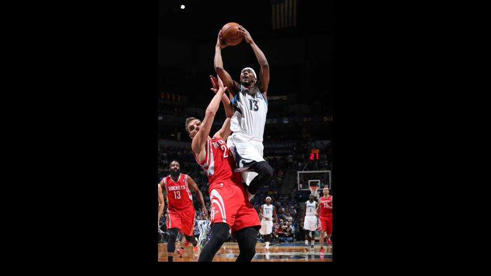 MINNEAPOLIS, MN - April 11: Corey Brewer #13 of the Minnesota Timberwolves drives to the basket during the game against the Houston Rockets on April 11, 2014 at Target Center in Minneapolis, Minnesota. (Photo by David Sherman/NBAE via Getty Images)