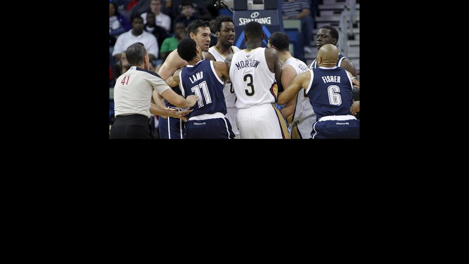 Oklahoma City Thunder forward Nick Collison, left, and New Orleans Pelicans guard Austin Rivers, third right, get into a scuffle in the first half of an NBA basketball game in New Orleans, Monday, April 14, 2014. Both were ejected from the game. (AP Photo