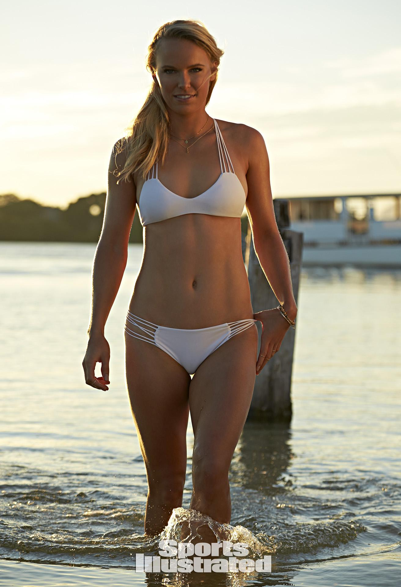 With her athletic body and Regular blond hairtype without bra (cup size 32C) on the beach in bikini