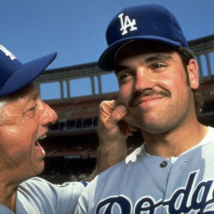 Dodgers manager Tommy Lasorda pinches the cheek of his rookie catcher, Mike Piazza, before a game in June 1993.