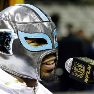 Here are some of the images that caught our eye on the sports night of Feb. 1, starting with Josh Norman of the Carolina Panthers wearing a mask as he answers a question during Opening Night for the NFL Super Bowl 50 football game in San Jose, Calif.