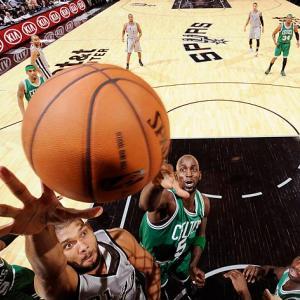 San Antonio's Tim Duncan drives to the basket against Boston's Kevin Garnett.