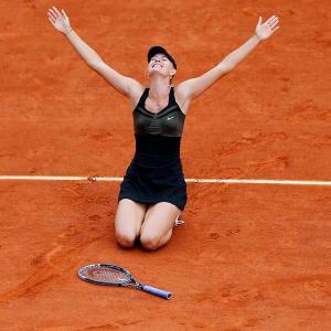 Maria Sharapova celebrates her 6-3, 6-2, French Open final victory over Italy's Sara Errani. Sharapova has now won each grand slam tournament once in her career.