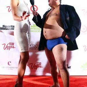 Welcome to Did You See That?, the gallery that artfully blends the worlds of sports, pop culture and high fashion into a savory stew. Here we have Guillermo (right), who clearly dreams of gracing the cover of next year's SI Swimsuit Issue, asking a model for tips on how to maintain his buoy-ish figure during the gala bash at The Cosmopolitan of Las Vegas.