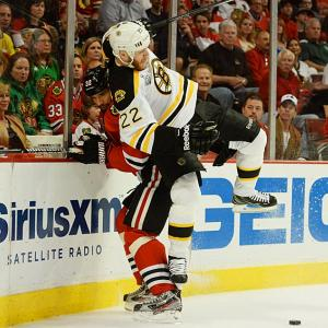 The Bruins' Shawn Thornton checks Michal Rozsival of the Blackhawks during Game 2 of the Stanley Cup finals.