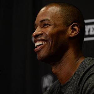 Jason Collins became the first openly gay athlete in the NBA on Sunday, signing with, and then playing in a game for the Brooklyn Nets. SI was in Los Angeles to photograph the event.