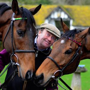 Welcome to another installment of Did You See That?, the weekly gallery that's always horsing around. Here we have a wily trainer mugging with Champion Hurdle entry My Tent Or Yours (left) and defending Gold Cup champ Bobs Worth (right) in Lambourn, England.