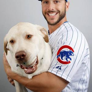 George Kottaras with his dog Leo during Cubs photo day in 2014.