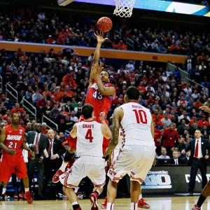 SI's best photographs from Thursday's games in the NCAA tournament. Vee Sanford was the hero of the day for Dayton, hitting this shot in the closing seconds to lift the Flyers over Ohio State. SI Video: Dayton knocks off Ohio State