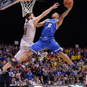 SI's best shots from Friday's Sweet 16 games, starting with the showdown between Kentucky and Louisville. Luke Hancock stopped Aaron Harrison from scoring on this play, but the Wildcats prevailed in the end.