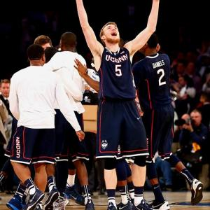 SI's best shots of the regional finals, in which the Final Four pairing of Florida, Connecticut, Kentucky and Wisconsin was produced. Niels Giffey celebrates UConn's victory over Michigan State, which made the Huskies the first No. 7 seed to reach the Final Four since the tournament expanded to 64 teams in 1985.