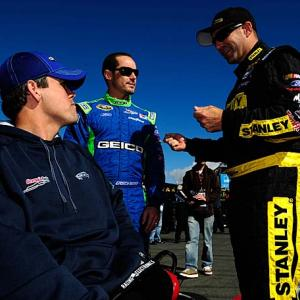 Casey Mears, center, and Marcos Ambrose, right (pictured here during happier times), got into an altercation April 25 in Richmond, during which Ambrose punched Mears in the eye.