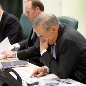 Miami Dolphins owner Steve Ross, right, looks over notes as general manager Jeff Ireland and head coach Joe Philbin, left, do the same just a short while before the Dolphins made their first selection in the 2012 NFL draft, quarterback Ryan Tannehill of Texas A&M at No. 8 overall.