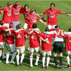 Bayern Munich players celebrate the 20th Bundesliga title in club history. The Bavarians also won the German Cup, the unprecedented second straight year in which they accomplished the