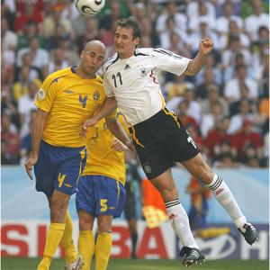 Germany's Miroslav Klose (right) and Sweden's Teddy Lucic battle for a ball in Saturday's matchup.