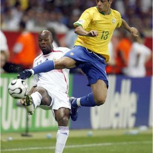 Juninho gets major hang time in battling for a ball with France's Sylvain Wiltord.