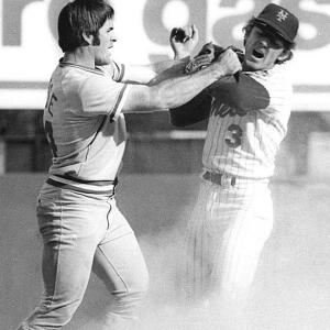 Pete Rose and Bud Harrelson scuffled in the fifth inning after Rose slid hard into second base trying to break up a double play, instigating a 10-minute bench-clearing brawl. Rose was pelted with garbage and bottles when he went out to left field in the bottom of the inning.