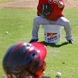 Ken Griffey Jr. tosses a pitch to his 4-year-old son, Tevin.