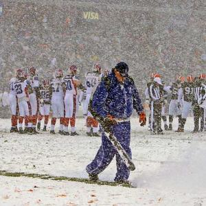 The snow began falling -- actually blowing sideways -- off Lake Erie about 1 1/2 hours before kickoff.