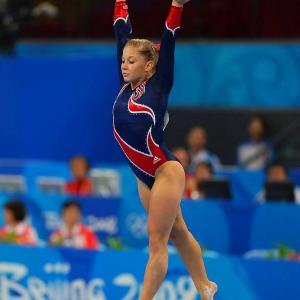 Shawn Johnson, 16, struck gold in the balance beam Tuesday in Beijing. After collecting three silver medals earlier in the games, the West Des Moines, Iowa gymnast showed her best in the final women's competition event.