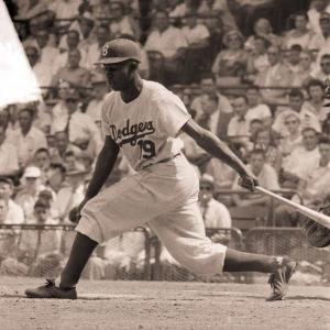Jim 'Junior' Gilliam wins the National League Rookie of the Year Award. The Dodger second baseman easily beats Harvey Haddix and Ray Jablonski.