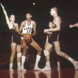 Wilt Chamberlain scores 52 points in his first collegiate basketball game.