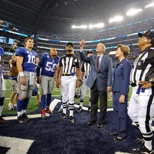 For the Giants-Cowboys game, we asked our photographers to train their lenses on Eli Manning, who's already won one Super Bowl and would love to add a second. Here's a look at the Giants QB outside the huddle, beginning with his inclusion in the coin toss by former President George W. Bush.