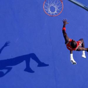 Here are some of the favorite shots of Sports Illustrated photographer Walter Iooss Jr, beginning with Michael Jordan.  The `blue dunk' picture was taken in Lisle, Ill. Because Michael and I hadn't discussed which uniform he was going to wear, I had my assistants paint this huge parking lot -- one section red and one section blue. When he showed up in his red uniform, we set up on the contrasting blue court. I had a basket on wheels, so I could shift it into position so the shadow would be in the right place.