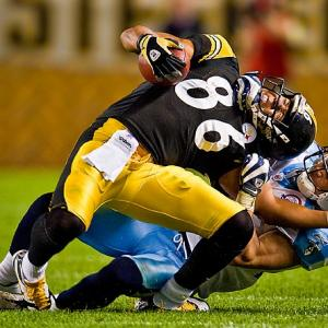 With a tight grip on Hines Ward's chin and shoulder, Titans cornerback Cortland Finnegan wrestled the Steelers wide receiver to the ground during the two teams' season opener in Pittsburgh on Sept. 10.