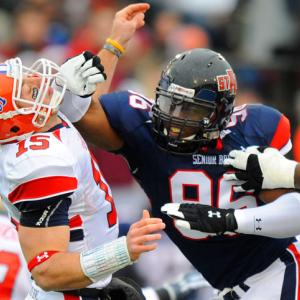 South quarterback Tim Tebow of Florida is pressured by North defensive end Alex Carrington of Arkansas State during the Senior Bowl in Mobile, Ala., on Jan. 30. The North defeated the South 31-13.