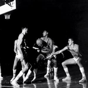 The 1957 NCAA tournament final had it all -- two storied programs, one of the greatest players to ever touch a basketball, and three overtimes to boot. The Tar Heels tripled-teamed Kansas' Wilt Chamberlain for most of the game, jumping out to a 19-7 lead early in the first half. But Wilt and the Jayhawks roared back to send the game into overtime. With no shot clock in college basketball yet, the teams scored just two points each in the first extra period, and in the second, zero points each. UNC finally outlasted Kansas thanks to two clutch free throws from Joe Quigg with fewer than 10 seconds left in the third overtime.