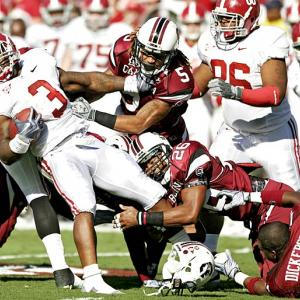 Many cautioned that Alabama was heading into a trap game against a South Carolina team coming off a bye. Those warnings proved correct, as the No. 1 Tide fell to the Gamecocks, 35-21. Stephen Garcia and Marcus Lattimore each registered three touchdowns, while the Gamecocks' defense held the ferocious rushing tandem of Trent Richardson (pictured) and Mark Ingram to 61 combined yards on the ground. It was South Carolina's first-ever win over a team carrying a No. 1 ranking.