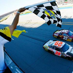 Kevin Harvick (29) and Clint Bowyer (33) crossed the finish line in that order, but a last-lap caution had frozen the field earlier and officials determined Bowyer was leading at that point, so he was awarded the victory.