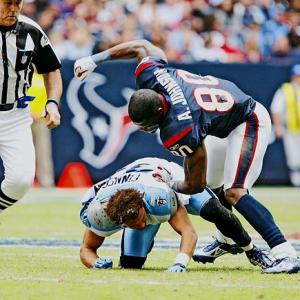 Provoked by face-mask pushing by Titans cornerback Cortland Finnegan, Texans wide receiver Andre Johnson ripped Finnegan's helmet off, punching him two times. Finnegan then tore off Johnson's helmet before the refs finally restored order, and both players were fined $25,000.