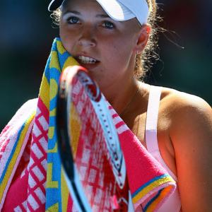 Caroline Wozniacki of Denmark wipes her face with a towel during Saturday's fourth-round match against Latvia's Anastasija Sevastova at Melbourne Park. The top-seeded Wozniacki won 6-3, 6-4 to advance to the quarterfinals, where she will meet Francesca Schiavone.