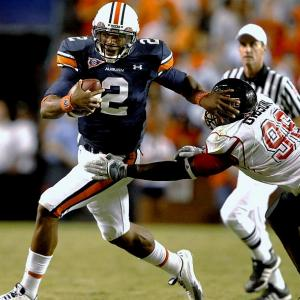 After transferring from Blinn College to Auburn in January 2010, Cam Newton won the starting quarterback job during spring practice.  He had led Blinn College to the NJCAA national championship the previous season, but few knew what to expect when he made his debut against Arkansas State. Newton threw for 186 yards and three touchdowns and ran for 171 yards and two touchdowns during the 52-26 victory.