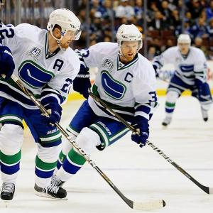 They've been connected their whole lives and teammates their entire NHL careers, so why stop now? On Friday (Nov. 1, 2013), Henrik and Daniel Sedin signed matching four-year contracts with the Vancouver Canucks, according to general manager Mike Gillis, a team they've played for since entering the league in 2000. The 33-year-old Swedes' deals are worth $28 million apiece. In 1999, the Sedin twins were regarded as two of the top prospects in the league and requested to play together, which led the Canucks to make a series of trades to grab them with the second and third overall picks. They both won gold with Team Sweden at the Turin Olympics in 2006. In honor of the Sedins, SI presents a gallery of other notable twins in sports.