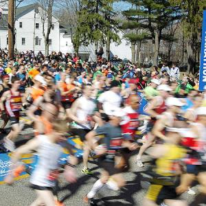 Runners cross the starting line of the 115th Boston Marathon in Hopkinton, MA. The sold-out field of 26,964 was the most since the 100th anniversary race in 1996.