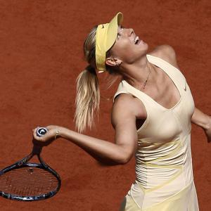 Russia's Maria Sharapova serves to Croatia's Mirjana Lucic during their first-round match Wednesday on Court Philippe Chatrier. The seventh-seeded Sharapova won 6-3, 6-0.