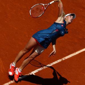 Caroline Wozniacki of Denmark serves during her second-round match wtih Aleksandra Wozniak of Canada. Wozniacki won 6-3, 7-6(6).